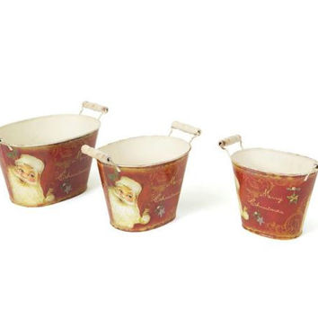 3 Retro Santa Buckets - Buckets Come In Three Different Sizes And Feature A Retro Santa Claus Design With Distressed White Handles On The Sides
