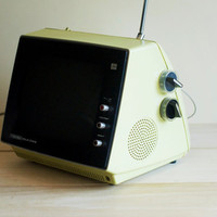 retro vintage television. yellow-green portable space age tv. midcentury clean design.