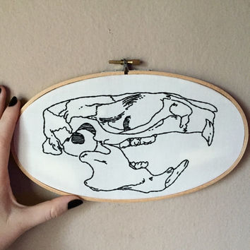 Hand embroidered rat skull in a large oval embroidery hoop, animal bones