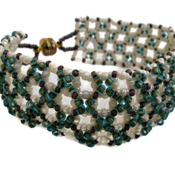 Seed bead bracelet in green and cream. Handmade beaded cuff.
