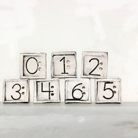 Square buttons imprinted with numbers 0 6 out of by Dprintsclayful
