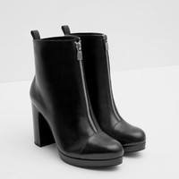 LEATHER PLATFORM HEELED BOOTIES WITH ZIP