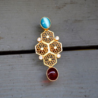 Red and Blue Gemstone Cocktail Ring with Hexagonal Accents