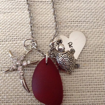 Sea Glass red pendant with turtle charm, starfish charm, and initial silver heart on silver filled chain.
