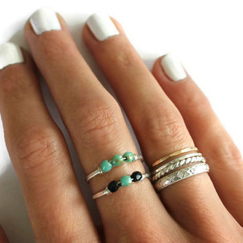 Sterling silver stackable ring adorned with black and turquoise beads