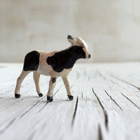 A sweet little calf. Vintage die cast toy calf. Britains or similar miniature metal die-cast toy calf. Circa 1930s.
