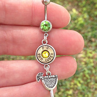 Belly button ring with bullet casing and margarita charm