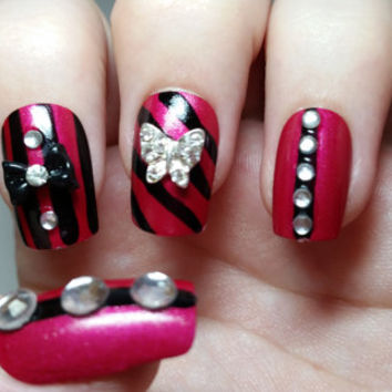 3D nail art Pink and black fake nails with black bows, butterflies and diamonds. Punk/Goth themed false nails acrylic press on nails