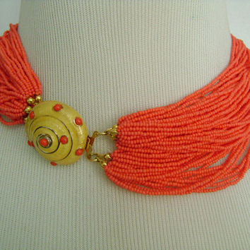 CAROLEE Multiple 60-Strands Vibrant Coral Colored Tiny Seed Glass Beads Torsade Necklace W/Yellow Enameled Seashell Clasp Perfect For Summer