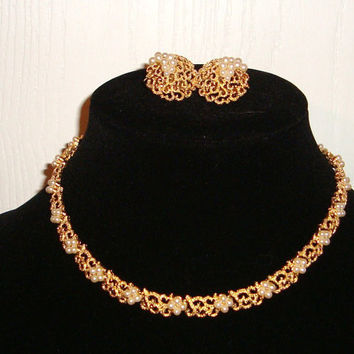 Golden necklace and earings encrusted with pearl by Trifari