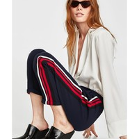 TROUSERS WITH MULTICOLOURED STRIPES DETAILS
