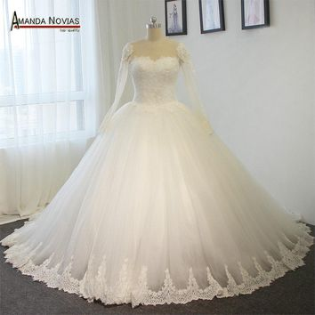 Bridal bouquet long sleeves backless wedding dress