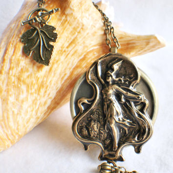 Music box locket,  round locket with music box inside, in bronze with Greek Goddess Athena on front cover.