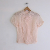 vintage pale pink lace shirt. sheer lace top. short sleeve blouse with buttons in the back