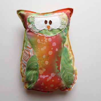 Handmade fabric owl in printed batik coral and green colors with a touch of vintage lace