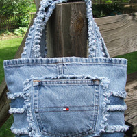 Denim tote made mostly from Tommy Hilfiger repurposed jeans. Snappy smaller bag, could be used as a purse. Denim patchwork, cute pockets.