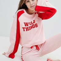 ASOS DESIGN Lounge Wild Things Long Sleeve Sweat & Jogger Set at asos.com