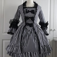 French Rococo Classic Lolita Dress for Women. Made in sizes 8 to 18 in Black and white stripe fabric. Pirate, Antoinette, Gothic Lolita.