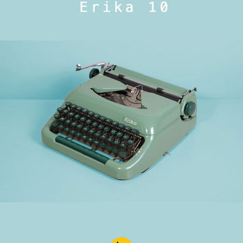 1950's Erika model 10 Typewriter. Elite typeface. Restored & full working condition. German portable vintage. Pistachio green color. Case.