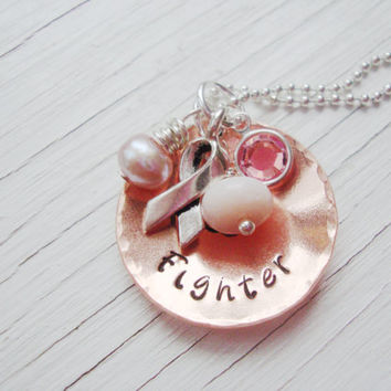 Fighter copper hand stamped necklace with silver ribbon charm, pink swarovski crystal charm, freshwater pearl and pink fire opal.