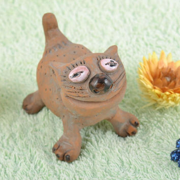 Handmade small collectible ceramic souvenir figurine of cat of brown color