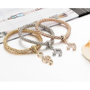 Fashion simple hollow carved three - color set of music diamond crystal ring popcorn stretch bracelet