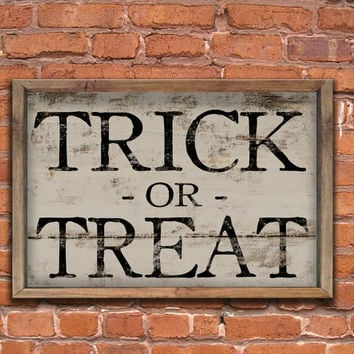 Trick or Treat wooden handmade sign framed out in reclaimed wood.  Aprox. 14x20x2 inches.
