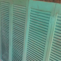 Your choice in color wooden shutter. Distressed