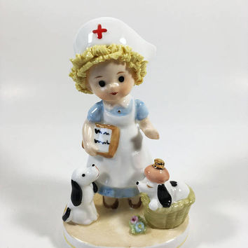 Nurse with Puppies Ceramic Collectible by Napcoware Bone China