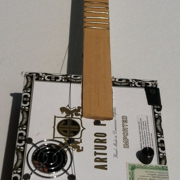 new (25 % off) Cigar Box Guitars on sale and/or strings