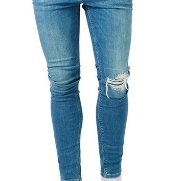 RIPPED SPRAY-ON SKINNY FIT JEANS