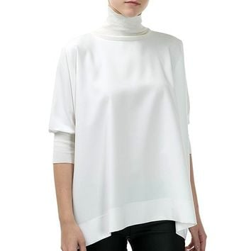 This an elegant oversized top featuring textured woven fabrication, 3/4 sleeves with ribbed knit cuff, and finished with ribbed knit turtleneck and zip closure. Pair with skinny jeans, ankle booties and black flappy hat. Unlined.
