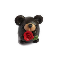 Miniature polymer clay bear sculpture, bear holding a rose figure, miniature bear figurine, miniature polymer clay animal sculpture.