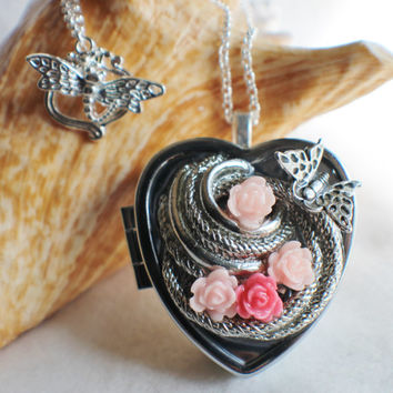 Music box locket,  heart shaped  locket with music box inside, in silver with silver accents, pink roses and a butterfly