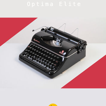 Early 1950's Optima Elite Typewriter. Refurbished, fully working and in excellent condition. Portable. East Germany. Glossy black. Case.