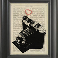 A Vintage camera with a small hearth   - Printed on the History of love page  -  250Gram paper.