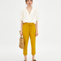 PANTS WITH SLIT AT HEM