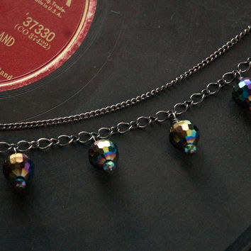 choker with rainbow, colorful faceted glass beads and two strands of gunmetal toned chain