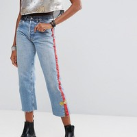 Reclaimed Vintage Revived Festival Levi's Jeans With Trim at asos.com